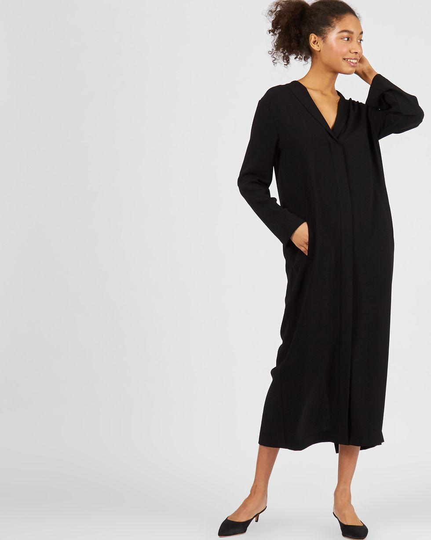 Платье миди со шлицей SПлатья<br><br><br>Артикул: 82913723<br>Размер: S<br>Цвет: Черный<br>Новинка: НЕТ<br>Наименование en: Long sleeve tunic dress