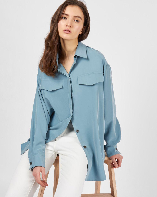 Блуза объемная One sizeРубашки<br><br><br>Артикул: 82813010<br>Размер: One size<br>Цвет: Серо-голубой<br>Новинка: НЕТ<br>Наименование en: Oversized flap pocket blouse